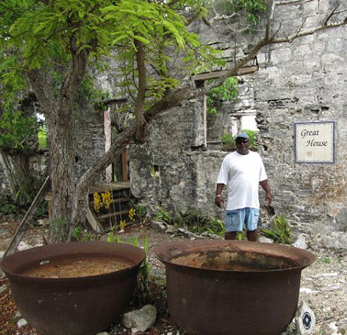 Captain Poach exploring the Old cooking pots at Wade's Green Plantation on North Caicos